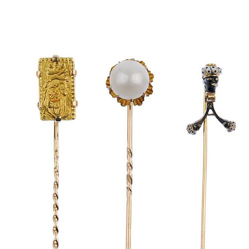 A selection of stickpins. To include two enamel blackamoor stickpins, the first set with a coral cab