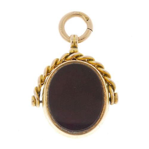 A late Victorian 15ct gold bloodstone and carnelian fob. The swivel fob with oval-shape bloodstone t