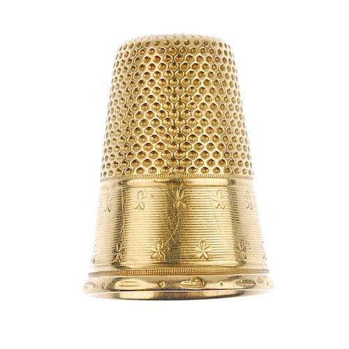 An early 20th century thimble. With vacant cartouche and floral border detail. French assay marks. L