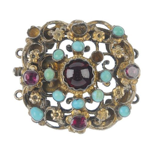 An Austro-Hungarian garnet and turquoise clasp. Of openwork floral design, the circular garnet caboc