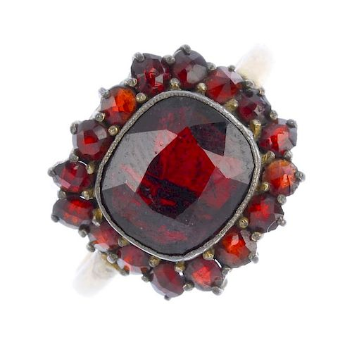 A selection of garnet jewellery and an early Edwardian 9ct gold paste ring. The marquise-shape blue