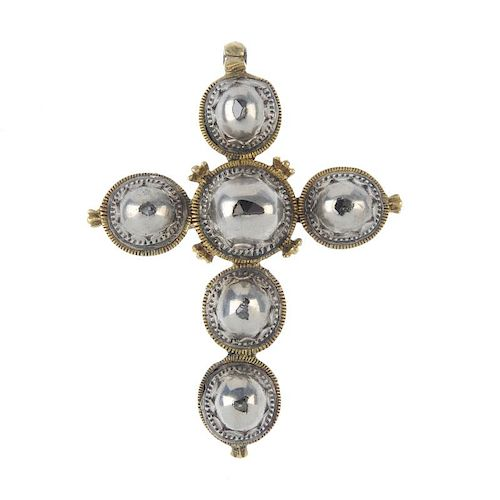 A diamond set cross. The flush-set diamond slivers to the five domed sections of the cross, the reve