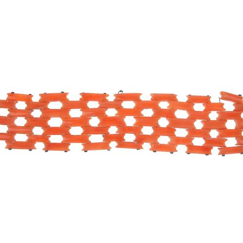 A late 19th century coral bracelet. Designed as a series of rectangular-shape coral links, to the gr