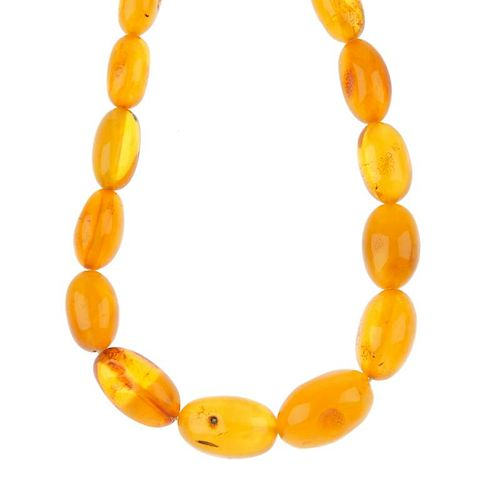 A natural amber necklace. Comprising forty-two graduated beads measuring 1.4 to 2.8cms. Length 80cms