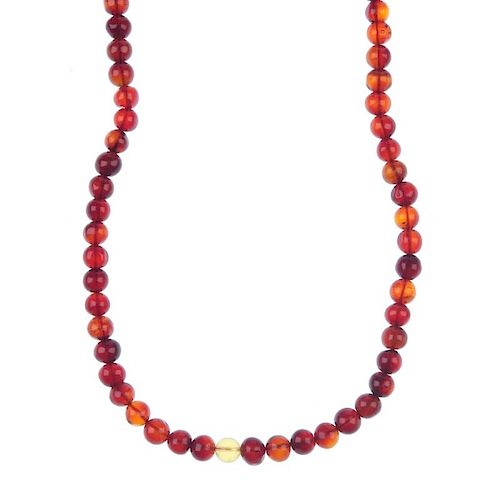 A natural Burmese blood amber necklace. Comprising 110 amber beads measuring 6 to 8mm, of mostly dar