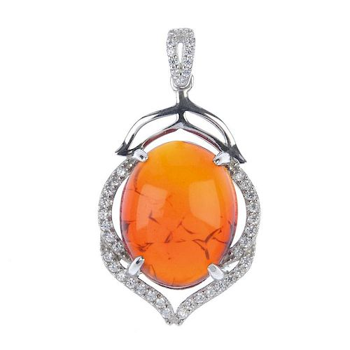 A natural Burmese blood amber pendant. Designed as a blood amber cabochon, measuring 1.7cms, set to