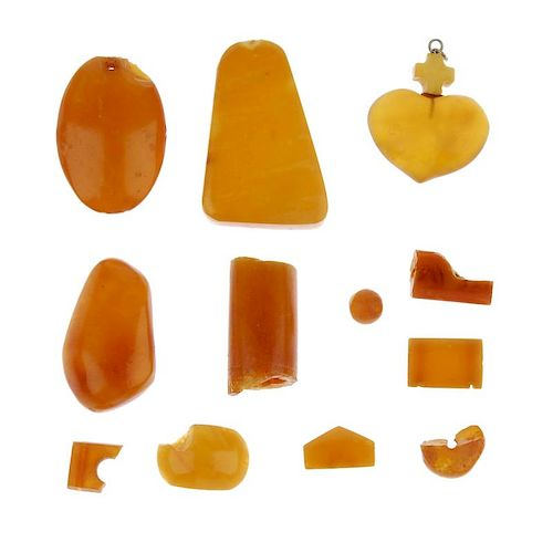 A selection of amber pieces. To include a selection of natural amber beads, a heart-shape pendant wi