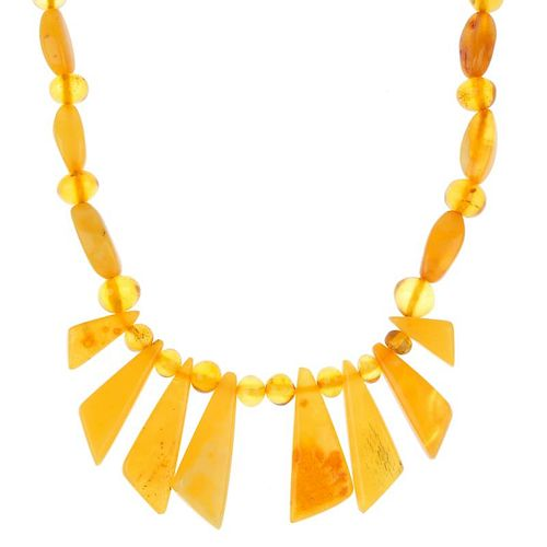 A selection of natural amber jewellery. To include a free-form amber bead necklace, a free-form ambe