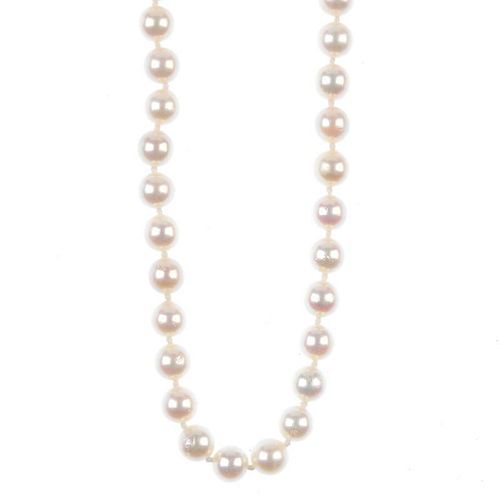 A cultured pearl single-row necklace, with diamond clasp. The cultured pearls, to the single-cut dia
