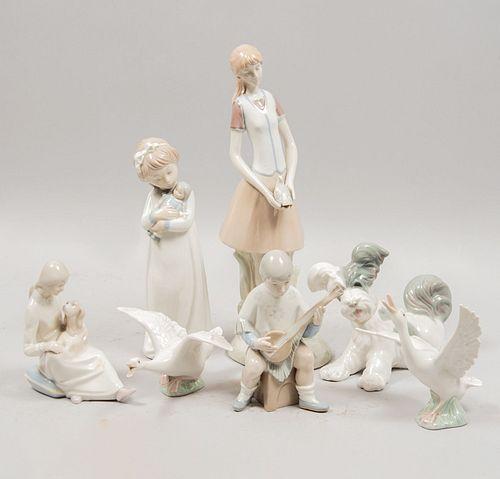 Lote de 7 figuras decorativas. España, SXX. Elaboradas en porcelana Lladró, Zaphir y otras. Acabado brillante.