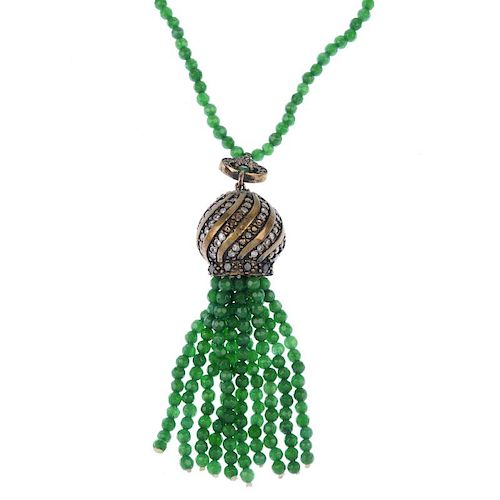 A dyed, treated jade necklace. The faceted circular beads suspending a metal ball with colourless pa