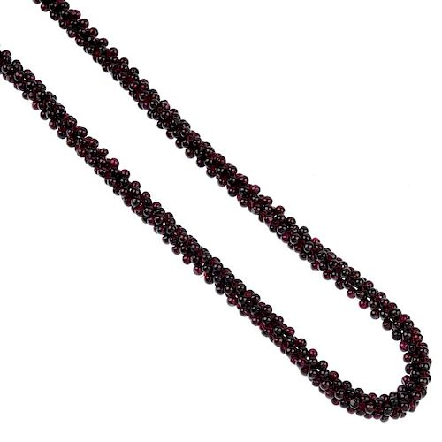 A selection of gem jewellery. To include a garnet necklace, designed as a series of woven beads, a f