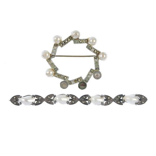 <p>Two brooches. To include one designed as a wreath with colourless pastes and cultured pearl inter