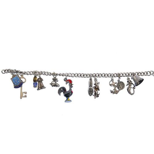 Four charm bracelets. Comprising a total of fifty-one assorted charms. One bracelet and fifteen char