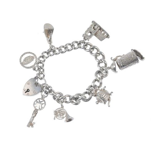 Four charm bracelets. Suspending a total of forty charms, to include a skier within a stein, an elep
