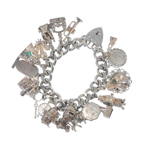 Two charm bracelets. The curb-link chains, suspending a total of fifty charms, to include a hinged b