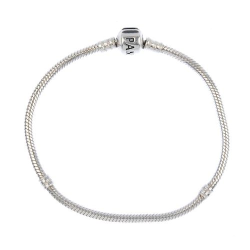 PANDORA - a bracelet and charms. To include two blue glass beads, together with a heart charm and tw