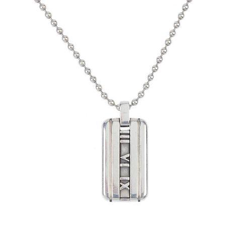 TIFFANY & CO. - a silver 'Atlas' pendant. Designed as a rectangular-shape tag, with signature Roman