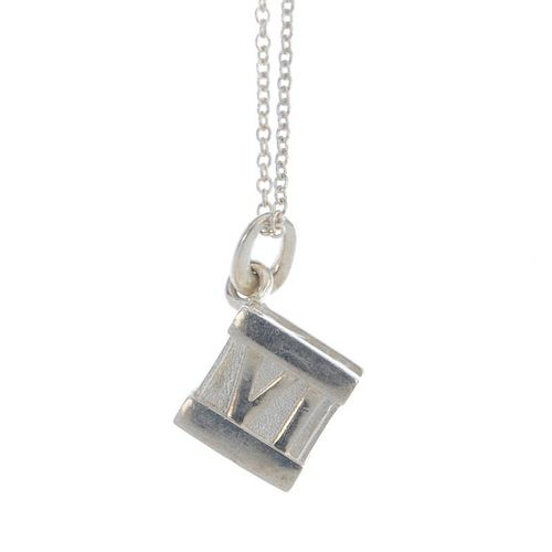 TIFFANY & CO. - a necklace, by Elsa Peretti for Tiffany & Co. Designed as a cube with Roman numeral
