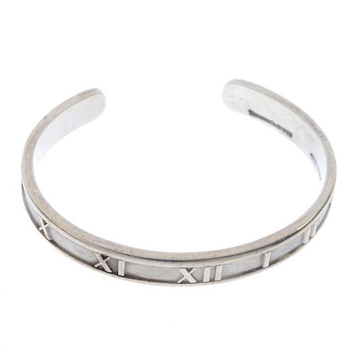 TIFFANY & CO. - an atlas bangle. The plain bangle with Roman numeral motif. Signed and dated Tiffany