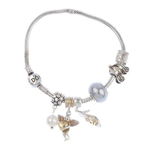 PANDORA - a charm bracelet with various designer and non designer charms. Including a Pandora cultur