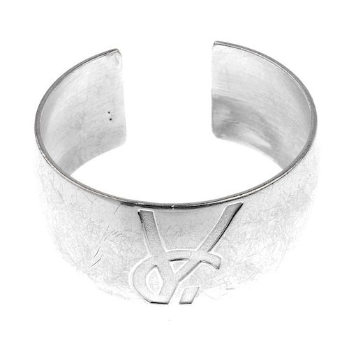 78547923d7c YVES SAINT LAURENT - a cuff bangle. The cuff with embossed YSL logo ...