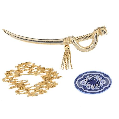 Three designer brooches. The first a Christian Dior brooch in the form of a gold-tone cutlass, suspe