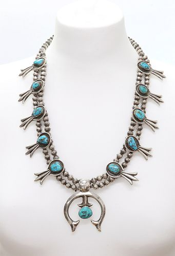 A silver Navajo turquoise squash blossom necklace,