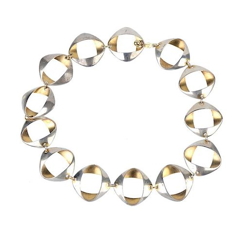 GEORG JENSEN - a silver necklace. Comprising a series of thirteen bi-colour oval-shape links, to the