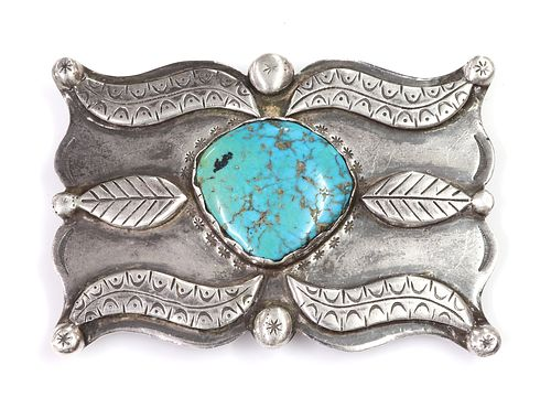 A silver Navajo turquoise set belt buckle, c.1970,