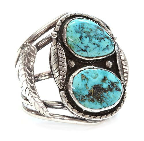 A silver Navajo turquoise set torque bangle or cuff,