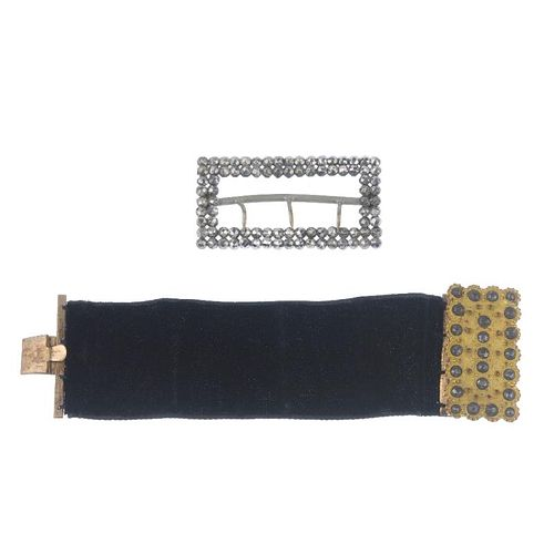 A selection of jewellery. To include two cut steel buckles and a Damascene cigarette case, together