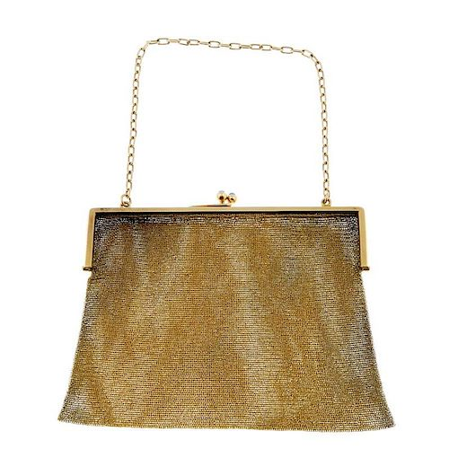 An early 20th century gold mesh bag. The 20ct gold square frame to the blue sapphire kiss clasp and