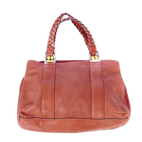 GUCCI - a bamboo bar tote. Crafted of soft coral pebbled leather, featuring two braided top handles
