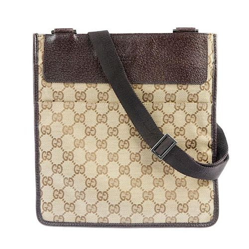 GUCCI - a GG small messenger bag. Featuring a maker's classic GG canvas exterior, brown pebbled leat