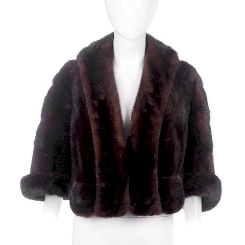A ranch mink bolero. Designed with an open front, featuring a collar with extended front panels, cro