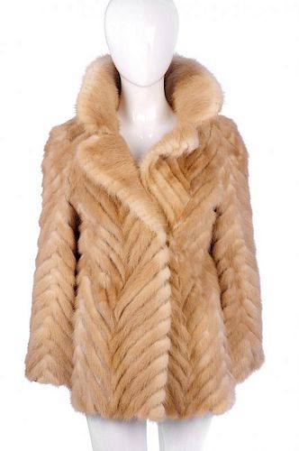 A chevron striped palomino mink jacket. Designed with a full mink notched lapel collar, hook and eye