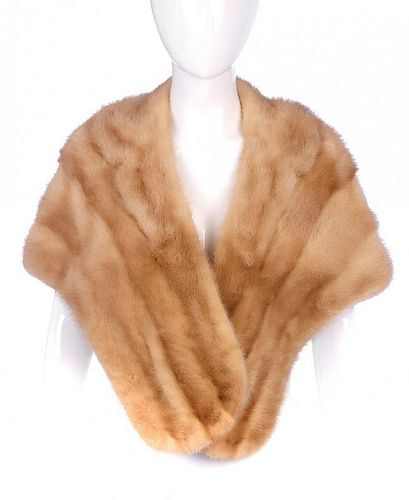 A dawn pastel mink stole. Designed with a notched lapel collar, two very small exterior pockets and