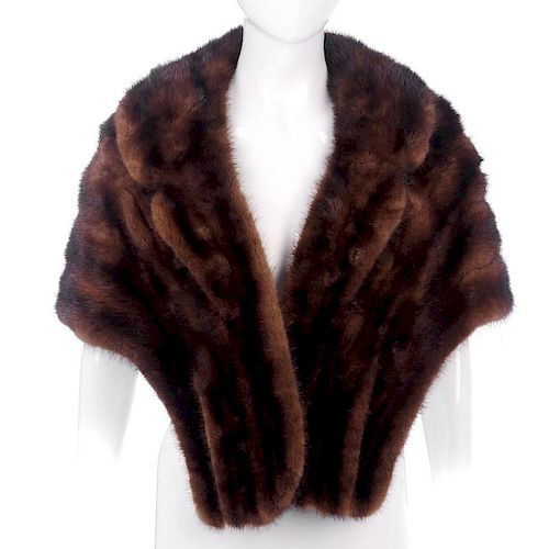 A ranch mink stole. Designed with a notched lapel collar, two outer pockets and an inner patch pocke
