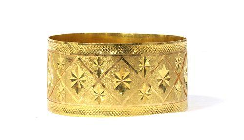 An Indian high carat gold bangle,