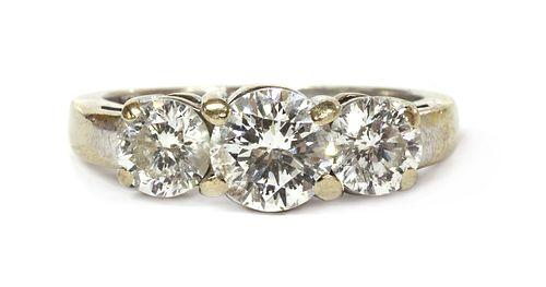 A white gold three stone diamond ring,