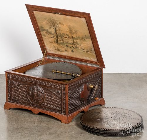 Regina music box with carved oak case and 24 discs