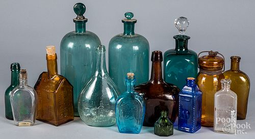 Collection of glass bottles, jars, and flasks