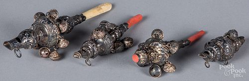 Four Victorian baby rattles/whistles