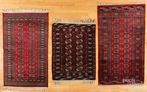 "Three Bohkara carpets, largest - 5'7"" x 3'2""."