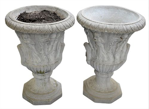 Pair of Outdoor Planters, each in the form of an urn with Neoclassical designs to body, height 31 inches, diameter 22 inches.