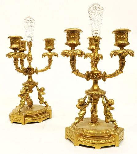 A Pair of bronze & Crystal Figural Candelabra