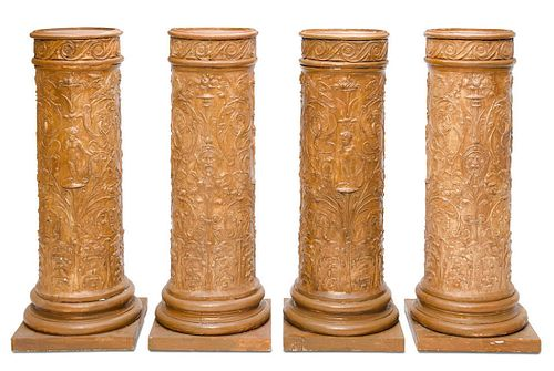 A SET OF FOUR PLASTER PEDESTALS