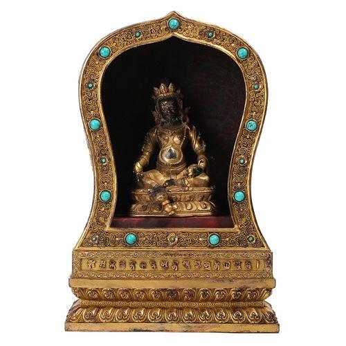 A GILT-BRONZE STUPA CONTAINING A BUDDHA
