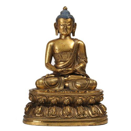 A GILT-BRONZE FIGURE OF SHAKYAMUNI BUDDHA
